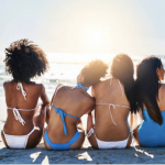 Women in bikins wondering does sunscreen cause cancer